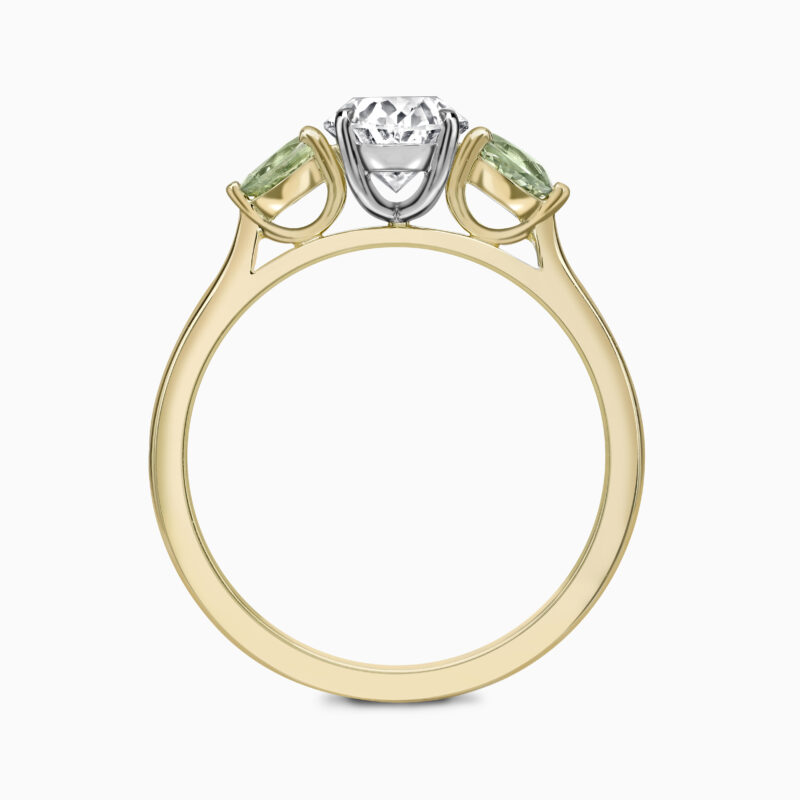 Oval Diamond And Green Sapphire Through Finger
