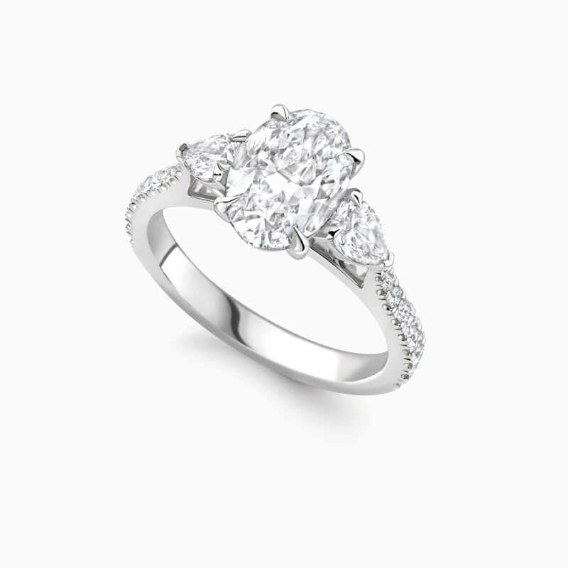 Oval cut and pear cut diamond trilogy ring